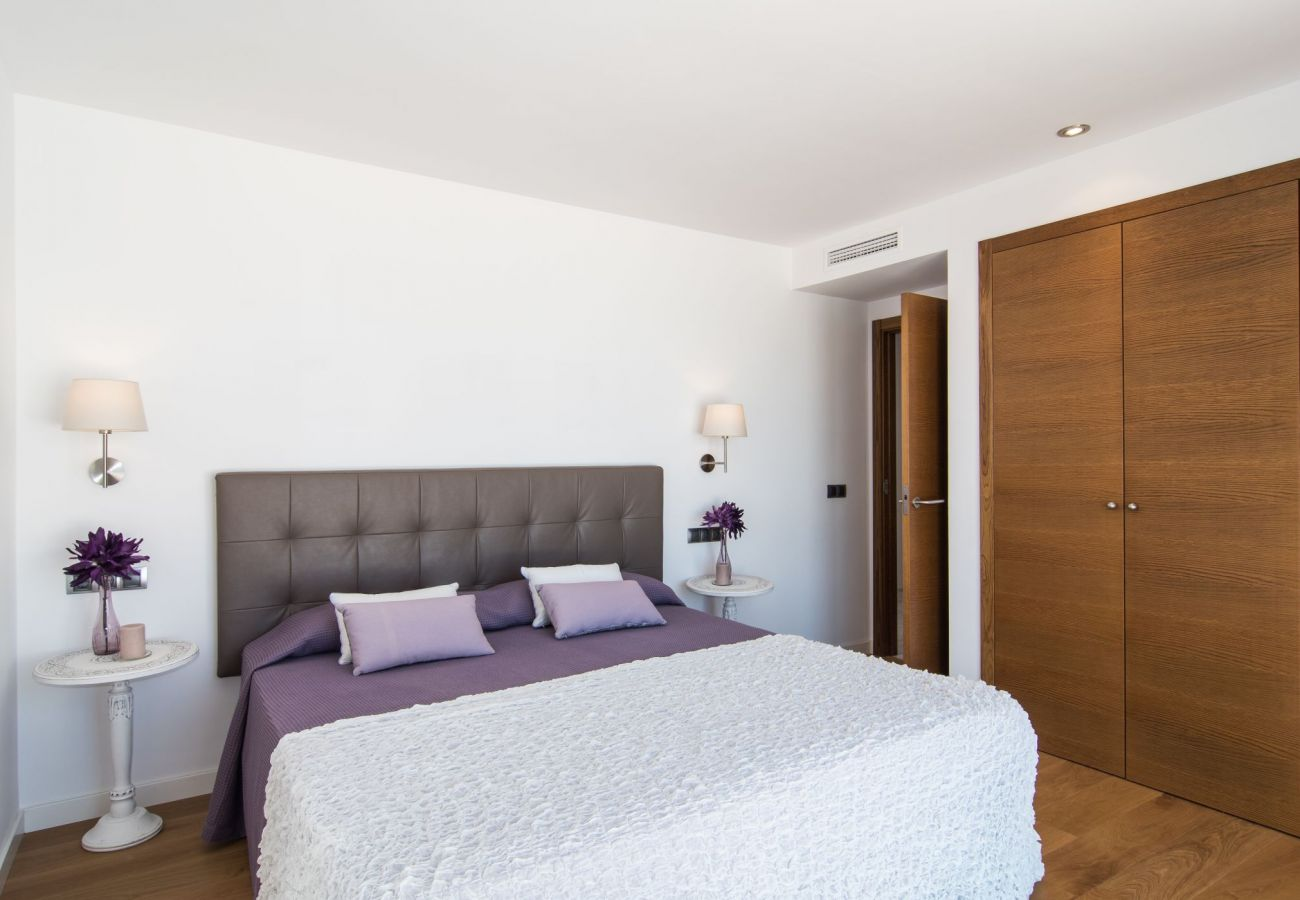 dormitorio doble en villa playa de muro