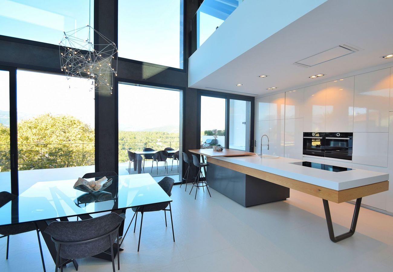 Foto der Küche und des Wohnzimmers des ferienhauses in buger