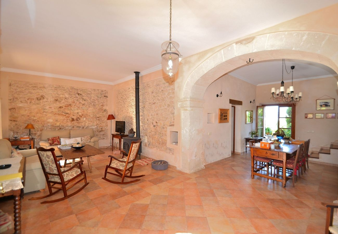 The villa has a large living room with capacity for 8 people