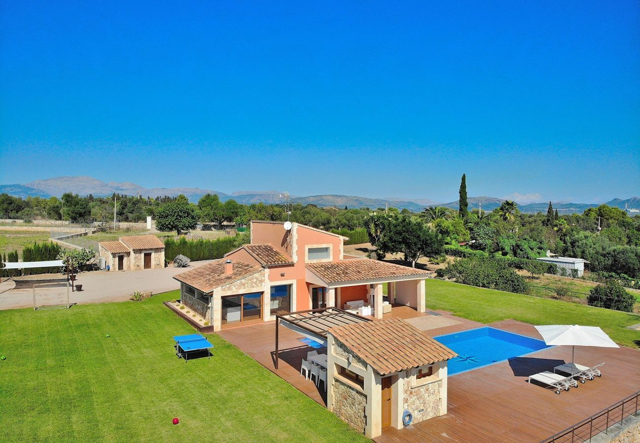 Aerial view of the villa with swimming pool in Can Picafort with garden