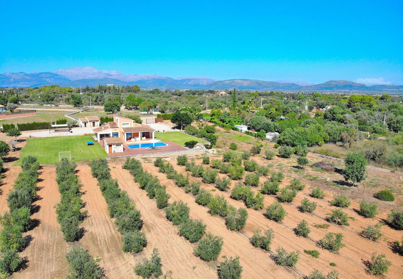 The villa has a private field