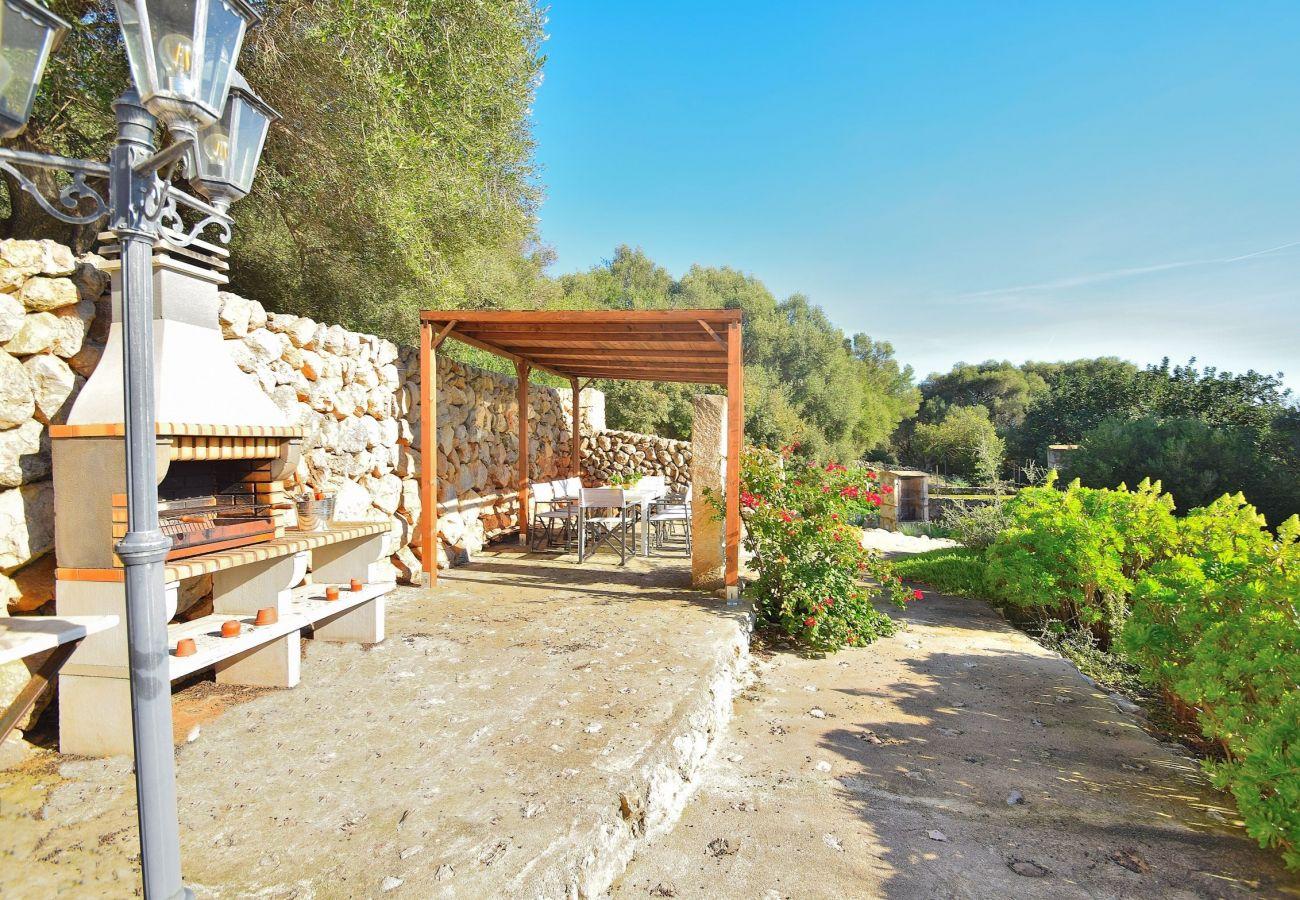 The villa in Alcudia has a terrace with barbecue