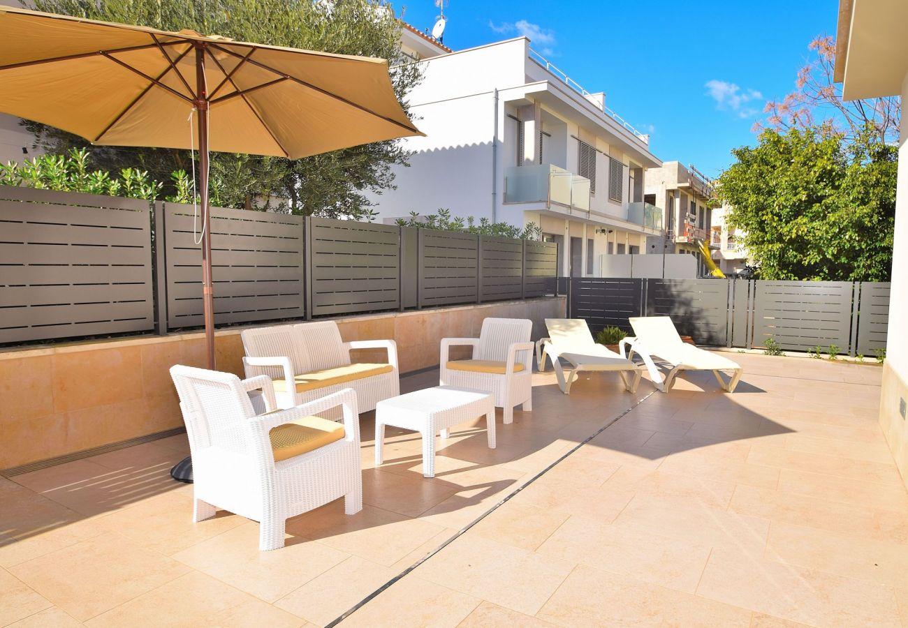 Terrace of the villa in can picafort mallorca luxury